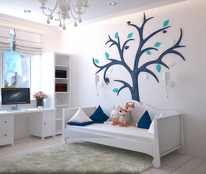 kid's bedroom with tree painted on wall.